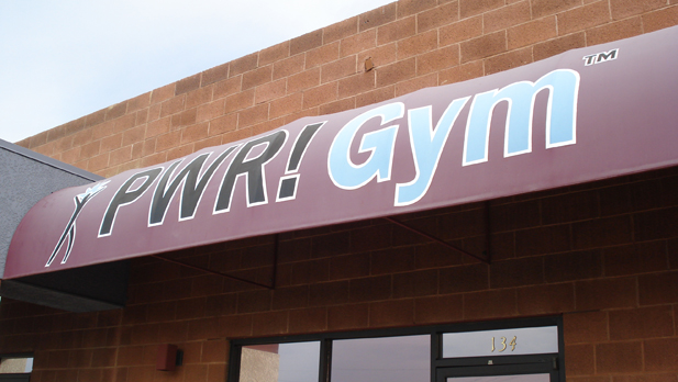 pwr gym sign spotlight
