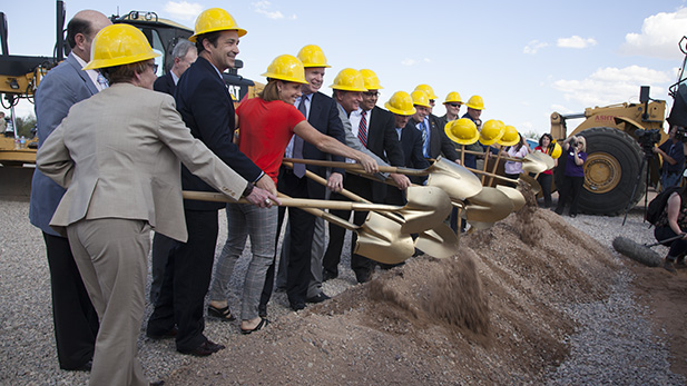 Elected officials from Tucson, Pima County and Arizona's congressional delegation scoop dirt in a ceremonial groundbreaking for the project to move Hughes Access Road a half-mile south of its location. The new road will be called Aerospace Parkway.