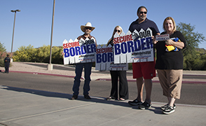 Small group gathered before immigration forum to protest Obama's executive actions