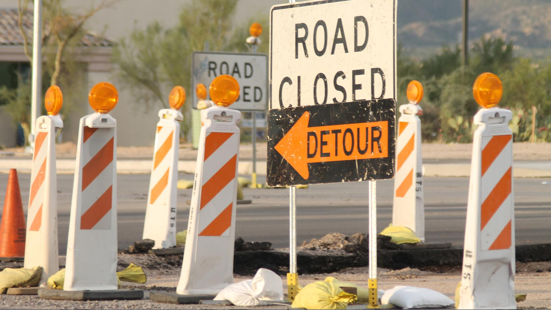 Detour signs at a road construction project.