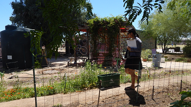 Molly Reed, an outdoor learning teacher, walks through Borton Primary Magnet School's garden.