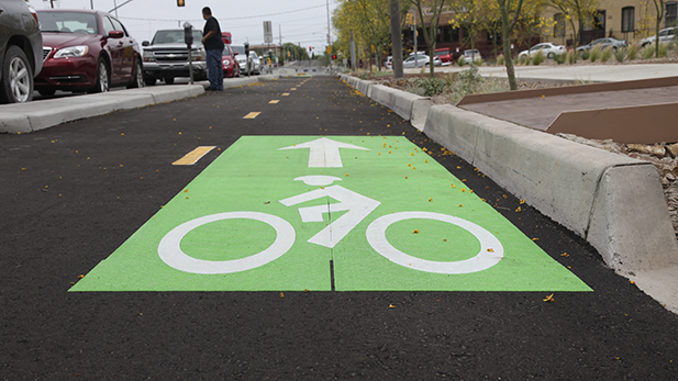 A protected bike lane on Stone Avenue between Toole Avenue and Alameda Street.