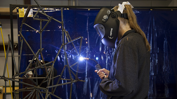 Freshman Katie Hicks welds at the Cracchiolo Family Science Technology Engineering and Mathematics Center on April 23, 2015.