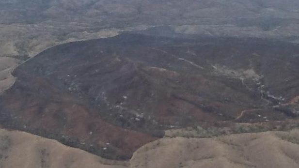 Smoke from Oak Tree Fire (center right) drifts to east. This aerial view is from the south with State Route 83 on left side.