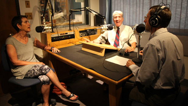 AZPM's Andy Bade (right) interviews the Tucson Symphony Orchestra's chorus director Bruce Chamberlain (middle) and chorus member Lois Manowitz (left).