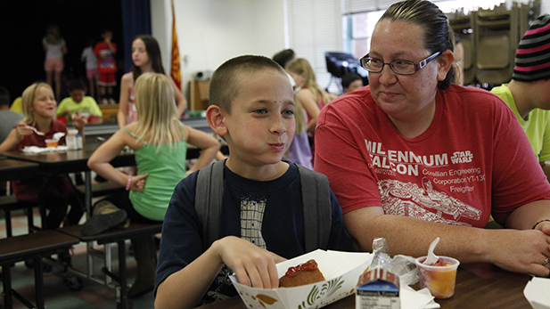 Johnny Collins, 8, is attending summer school at Kellond. His mom, Stephanie Collins, said the free meals ease the strain on the family's budget.