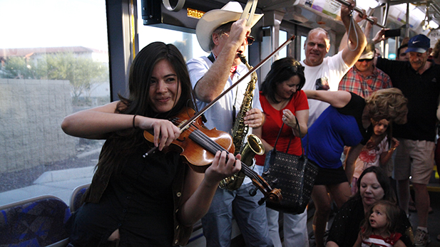 "Samantha Bounkeua, violinist with Jimmy Carr and The Awkward Moments said playing on the streetcar was ""exhilarating."" """"Musicians always play spontaneously so often so it's nice to play in different places because it keeps it so fresh,"" she said."