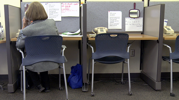 A woman calls potential employers from a phone bank at Pima County's Sullivan Jackson Employment Center