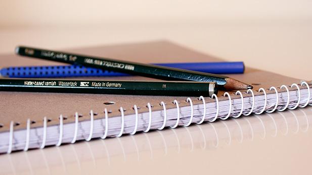 GED notebook pencils spotlight