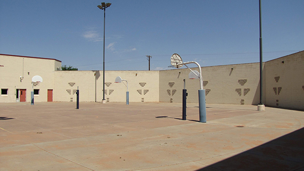 On this day the Western Navajo Nation Juvenile Detention Center's courtyard is empty. The tribe can't afford rehabilitative services or treatment for its youth.