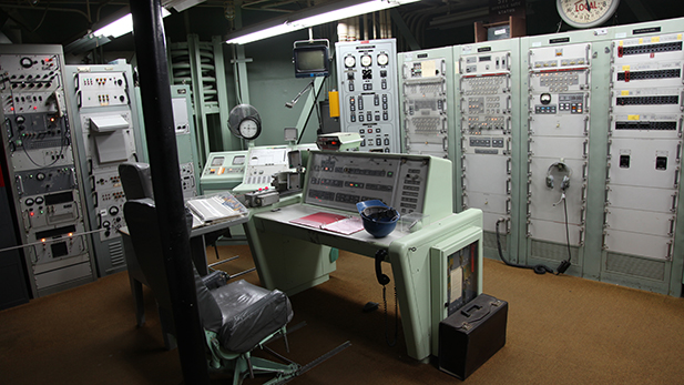 The control room where a Titan II missile would have been launched from. The room was staffed by at least two people at all times from when the site went online until it was decommissioned, but had spots for all four crew members to work from.