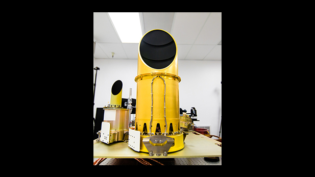 UA's completed camera suite, OCAMS, sits on a test bench that mimics its arrangement on the OSIRIS-REx spacecraft. The three cameras that compose the instrument are the eyes of NASA's OSIRIS-REx mission. They will map the asteroid Bennu, help choose a sample site, and ensure that the sample is correctly stowed on the spacecraft.