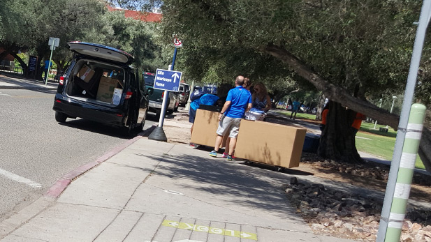 Students begin moving into the dormitories at the University of Arizona.