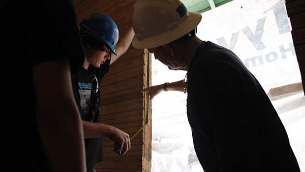 Cienega High School students measure windows in the kitchen that don't match the rest of the house. One of many oddities discovered in the the renovation.