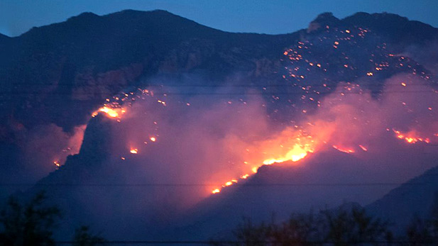 A lightning-caused fire burns near Finger Rock in the Catalina Mountains; August 5, 2015.