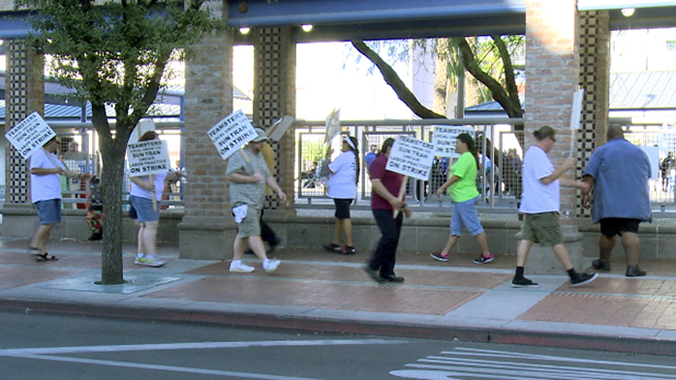 Sun Tran workers walk a picket line at Ronstadt Transit Center while on strike in August 2015.