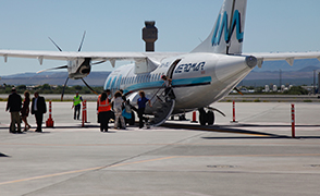 Passengers disembark from the first AeroMar plane to land in Tucson.