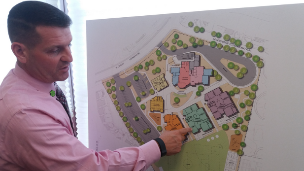 Principal Michael McConnell reviews a map of the Innovation Academy.