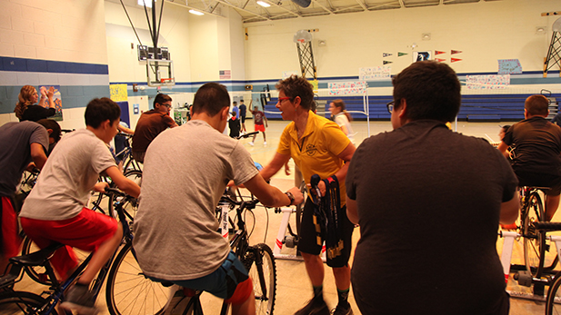 An Indoor El Tour bike ambassador encourages students at Billy Lane Lauffer Middle School.