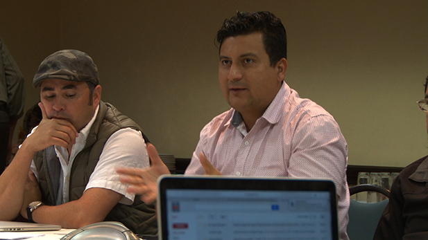 At right, Christian Ramirez, head of the Southern Border Communities Coalition, speaks at a meeting of immigration groups in El Paso, Texas, Nov. 16, 2016.