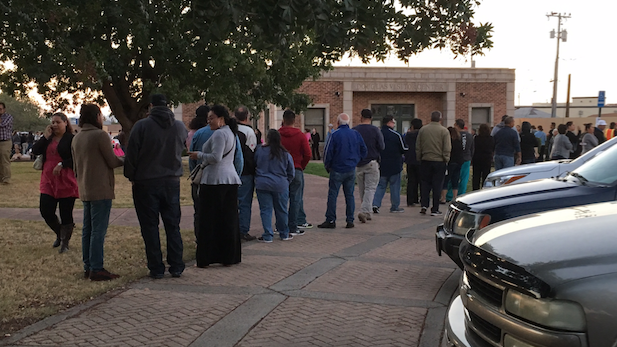 Voters wait outside the Douglas Visitors Center Tuesday after ballots ran out at the town's only polling place.