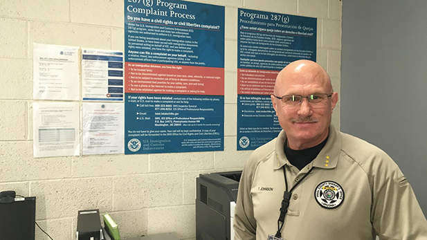Terry Johnson of the Pinal County Sheriff's Office stands in the section of the jail where officers interview non-citizens who might be deportable.