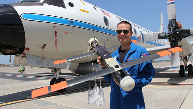 Hurricane researcher Joe Cione is leading NOAA's effort to use the Raytheon-produced Coyote unmanned vehicle with a P-3 aircraft to collect weather data to improve hurricane forecasting.