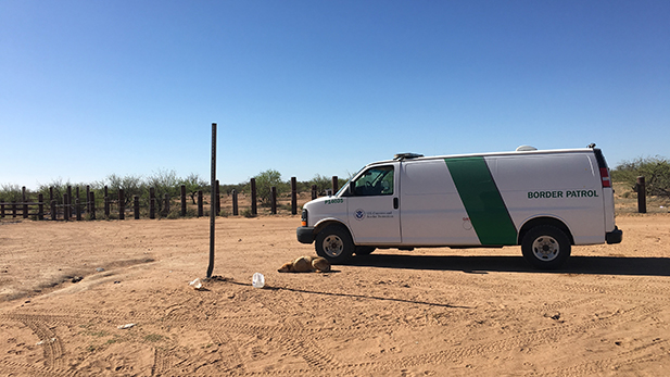 A lone Border Patrol agent watches over the San Miguel Gate.