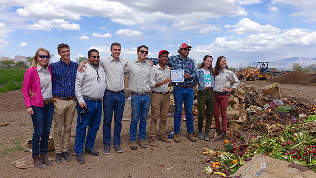 Members of the Compost Cats show their EPA award at the San Xavier Cooperative Farm.