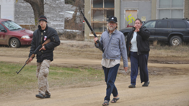 Kynan Dutton, Craig Cobb, and Deb Henderson patrol their neighborhood in Leith, North Dakota.
