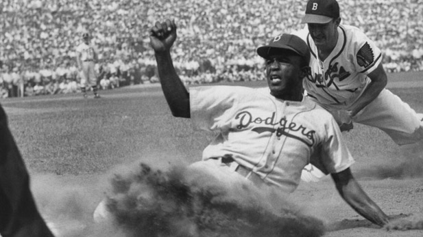Jackie Robinson slides into third base during a game.
