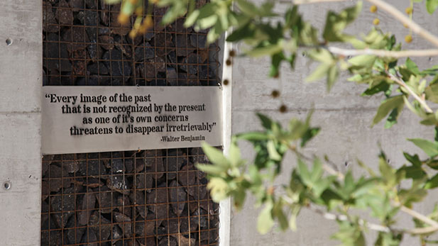 A quote from Walter Benjamin displayed in the open-air courtyard at the Holocaust History Center.
