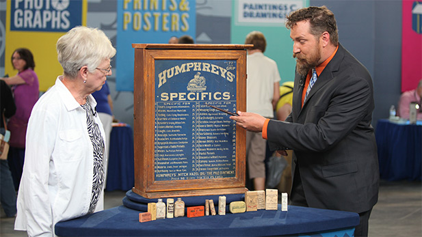 James Supp (right) appraises a Humphreys' homeopathic medicine cabinet in Omaha, Nebraska.