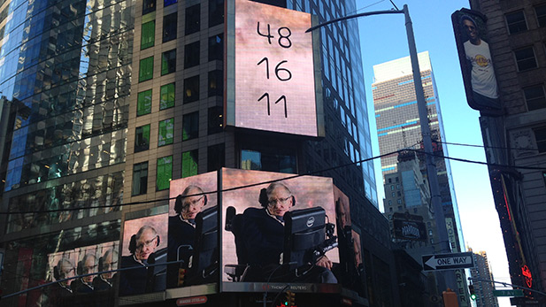 Image of Stephen Hawking appearing on a billboard in Times Square as part of Demo 1.