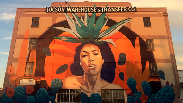 An agave goddess gazes from the side of the Benjamin Supply building on 6th Street and 7th Avenue in May 2016.