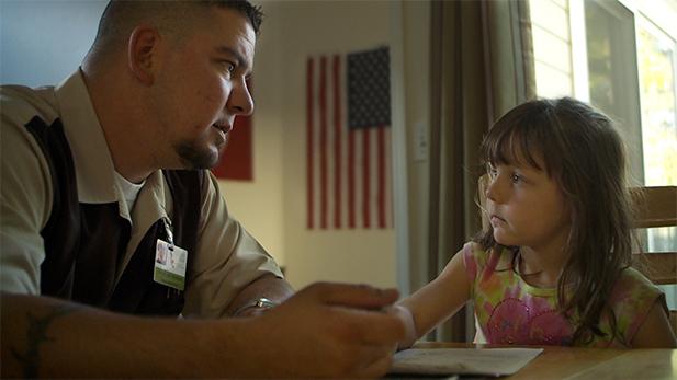 A veteran and his daughter at home.
