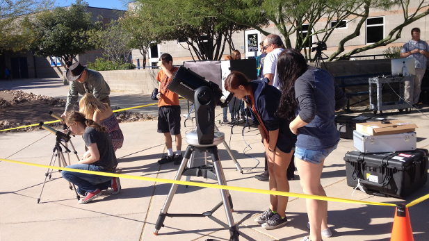 Students at Cienega High School in Vail use telescopes to observe Mercury passing between the Sun and Earth during the May 9, 2016, transit event.