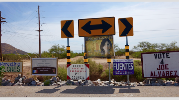Pascua Yaqui campaign signs at South Camino de Oeste and Calle Torim.