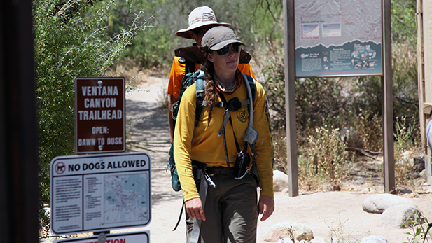 Volunteers with Southern Arizona Rescue Association return to the trailhead June 20. A hiker went missing, one was rescued and a third died on the trail June. 19, and the search continues for the missing hiker.