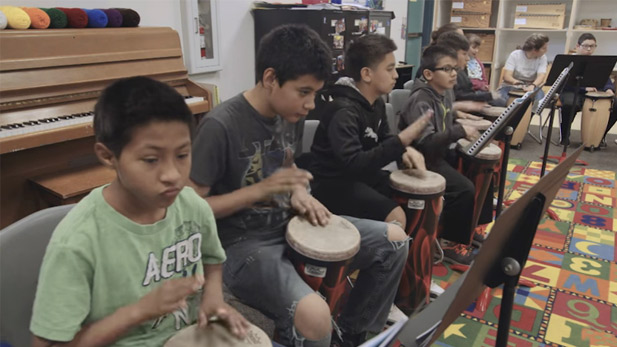 Students at Laguna Elementary School learn percussion.