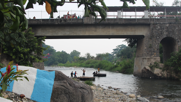 Bridge connecting Guatemala and Mexico on the Rio Suchiate. Guatemalans hoping to make it to the U.S. take rafts across.