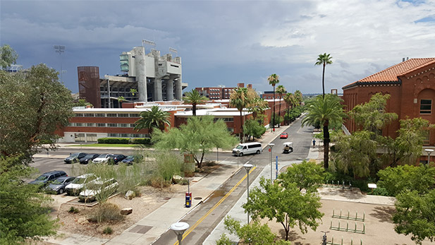Monsoon clouds darken the sky over the campus of the University of Arizona and Arizona Stadium.