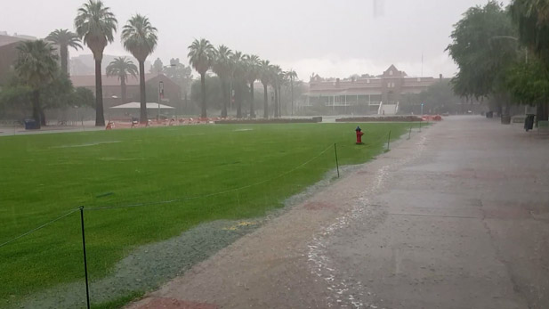 An intense rainstorm floods the mall on campus of the University of Arizona.