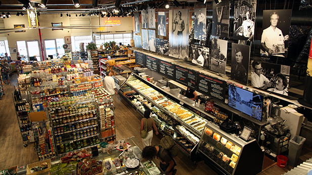 Johnny Gibson's Downtown Market opened in 2015, the only grocery store downtown. Its namesake is former barber and gym equipment retailer, shown in black and white photos above the deli.