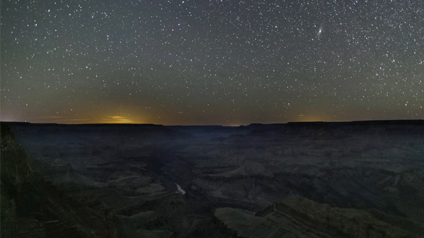 A field of stars lights up the night sky above the Grand Canyon in northern Arizona.