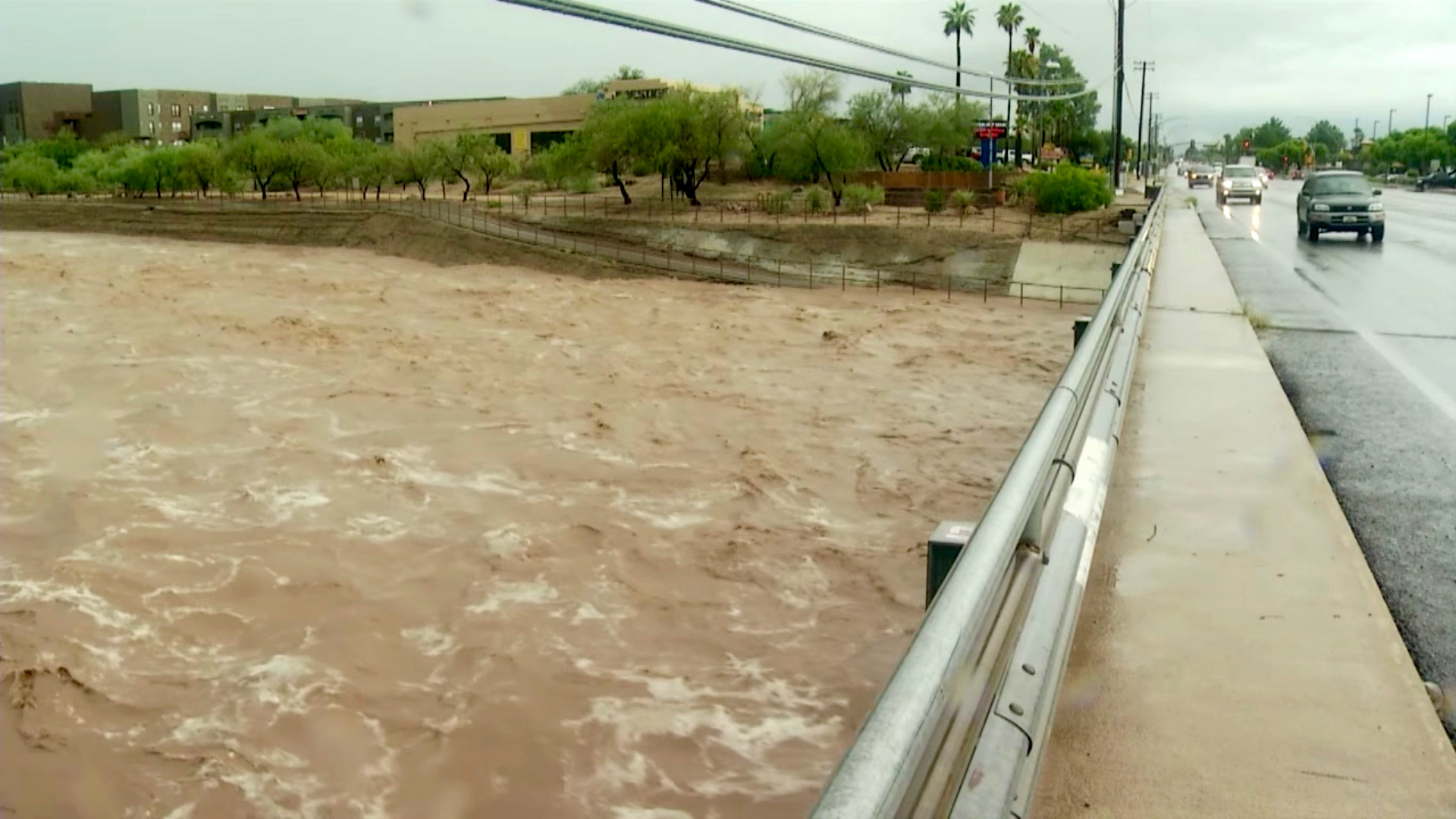 A wash in Tucson begins to flood its banks after heavy monsoon rain.