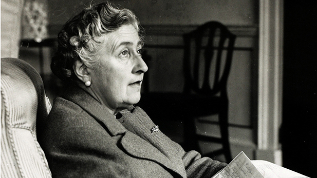 Agatha Christie writes in one of her many notebooks used to help construct her bestselling novels.