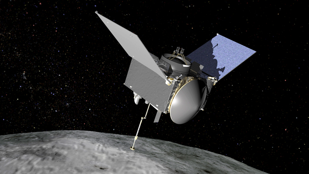 An artist's conception of the OSIRIS-REx spacecraft at the asteroid Bennu