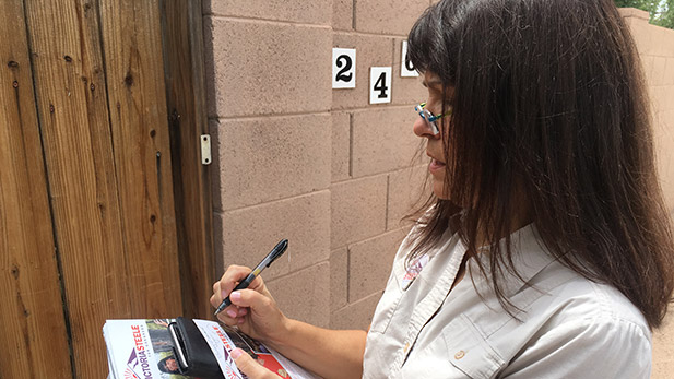 Victoria Steele, a candidate in the Democratic primary Arizona's 2nd Congressional District, leaves campaign literature while going door-to-door.  Summer 2016.
