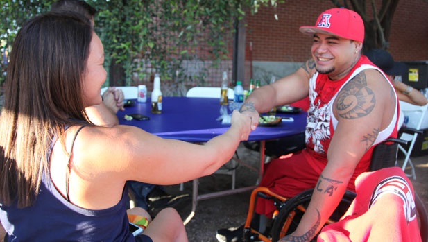 Paralympian athlete Shirley Reilly is greeted by a fan during the celebration.